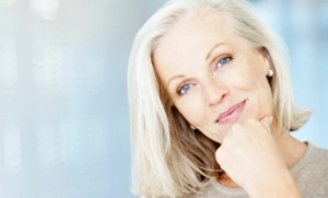 Portrait of a pretty mature lady with copy space